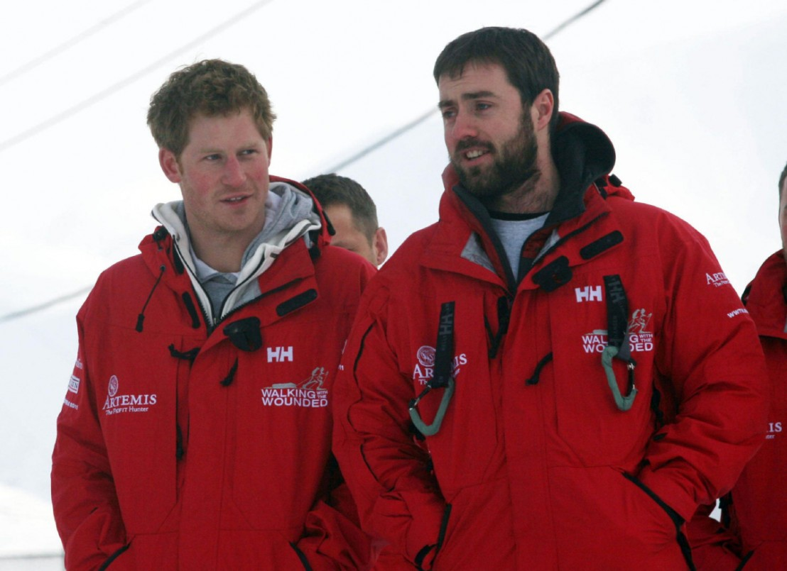 Britain's Prince Harry talks to Marti Hewitt as he meets Walking with the Wounded team members, on the island of Spitsbergen, between the Norwegian mainland and the North Pole