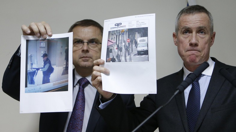 Paris prosecutor Molins and director of the Paris' judiciary police Flaesch show two photographs of the suspect gunman taken from surveillance footage  during a news conference in Paris