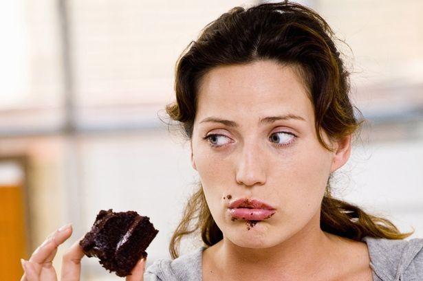 Woman-eating-chocolate-cake (1)