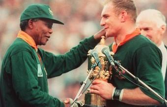 Springbok captain Francois Pienaar (R) receives th