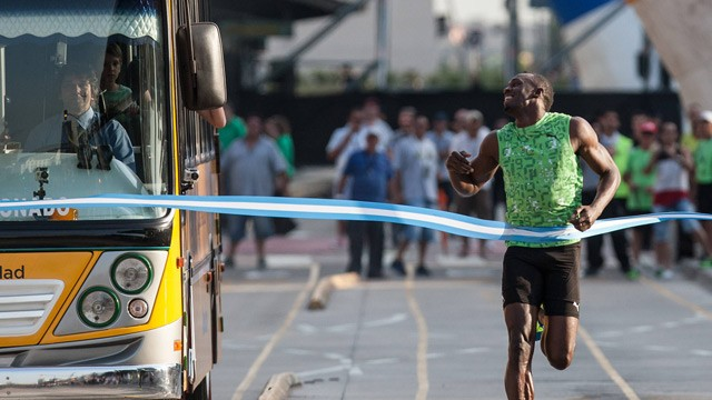 Usain Bolt Runs Against A Bus