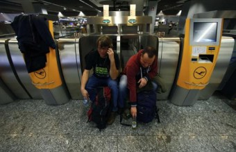 Flight passengers wait during a strike at Frankfurt airport