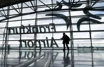 A passenger walks through a terminal during a strike at Frankfurt airport
