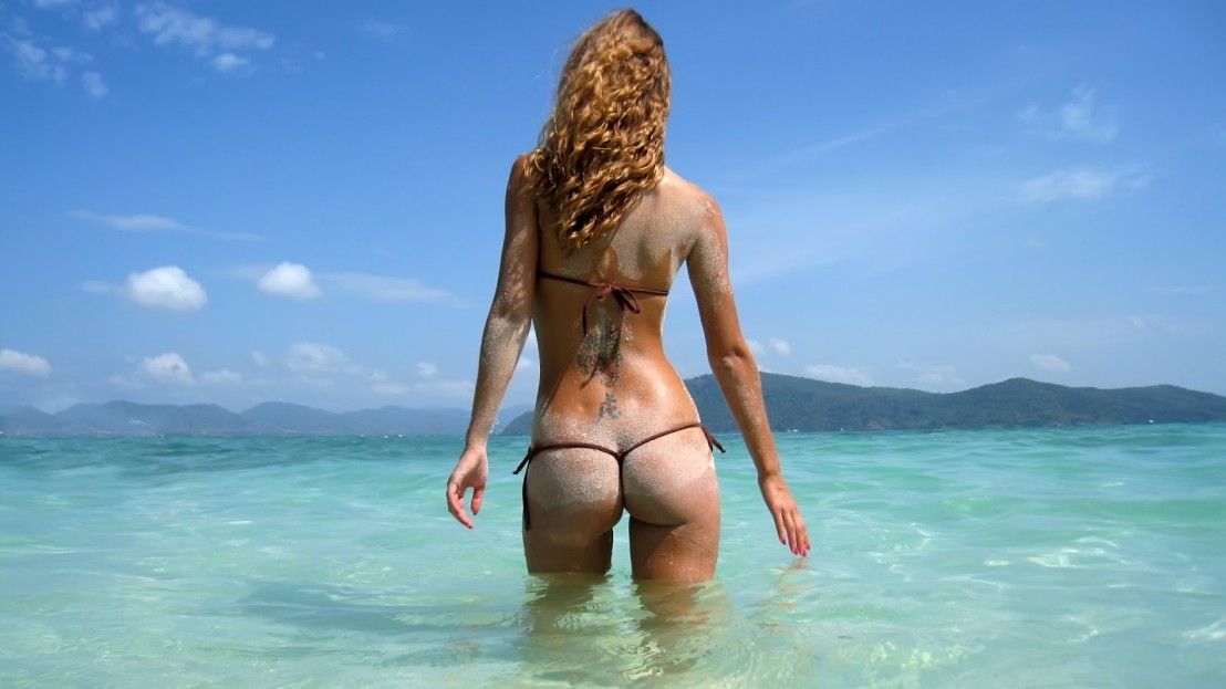 tattoos women ocean sand ass models thong curly hair 1920x1080 wallpaper_www.wallfox_net_15