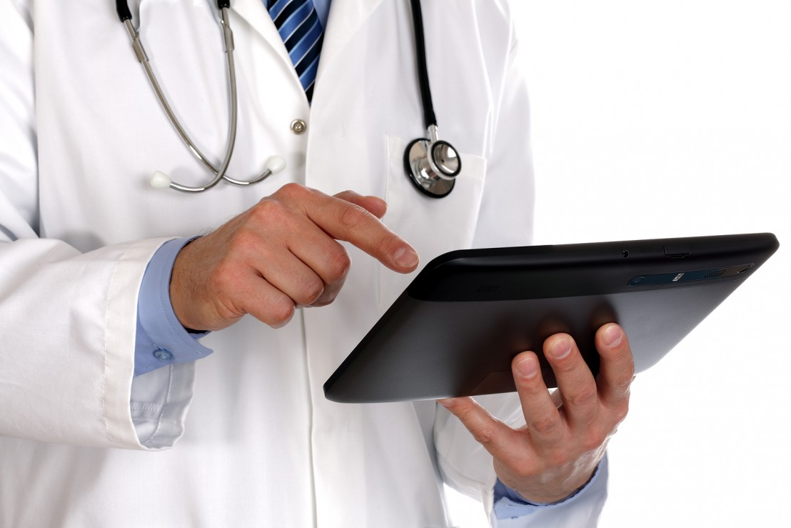 bigstock-doctor-using-a-digital-tablet-31270601