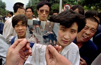 June 5, 1989 - People Show Photos of Dead Protesters (AP)