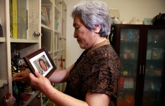 Tiananmen Square Nowadays - Zhang Xianling holds a photo of her late son Wang Nan (AP)