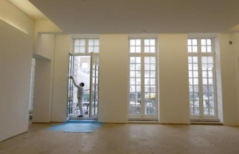A worker puts the final touch during the renovation of the Hotel Sale known as the Picasso Museum in the Marais district of Paris
