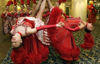 French cabaret dancers from the Moulin Rouge pose during a photo call in Rio de Janeiro
