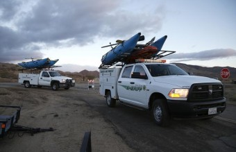 Search and rescue sheriff's vehicles arrive at the crash site of Virgin Galactic's SpaceShipTwo near Cantil