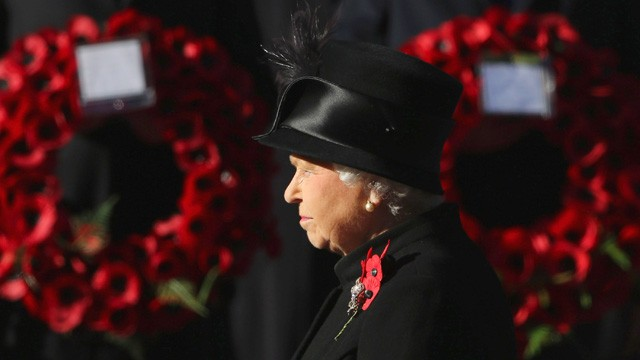 Queen Elizabeth II waits to lay wreath