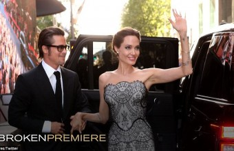 233B979500000578-2837645-Brad_Pitt_helps_his_wife_Angelina_Jolie_out_of_the_car_at_the_wo-6_1416257186003