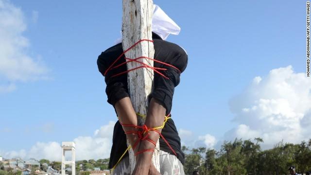 140327025443-somalia-execution-adan-sheikh-abdi-story-top