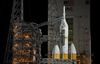 The Mobile Service Tower rolls back from the Delta IV Heavy with the Orion spacecraft on launch pad 37B at Cape Canaveral Air Force Station