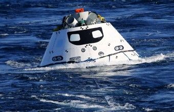 A test version of NASA's Orion capsule is towed towards the USS Anchorage during recovery drill off the coast of California