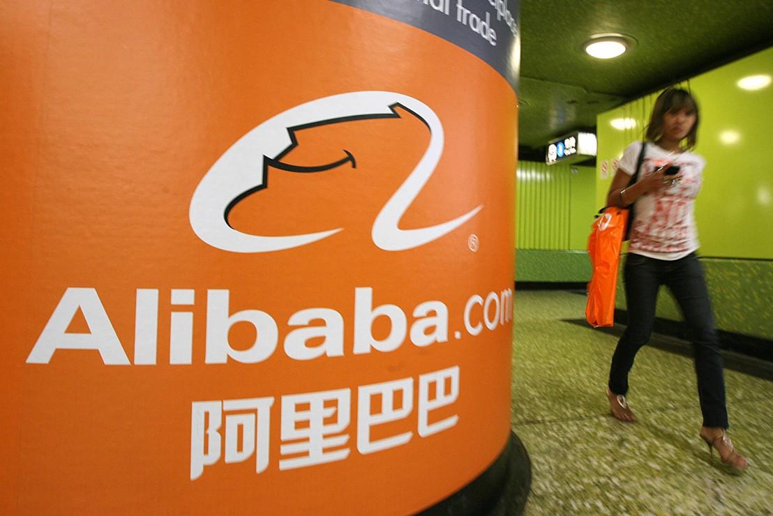 A pedestrian walks past Alibaba.com adve