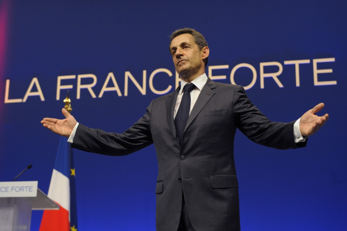 France's President and UMP party candidate for the 2012 French presidential elections Nicolas Sarkozy acknowledges the reactions of the audience at the end of an campaign rally in Nice
