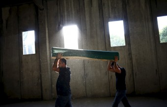 Men carry a coffin containing the body of a newly identified victim of the 1995 Srebrenica massacre at the Memorial Center in Potocari