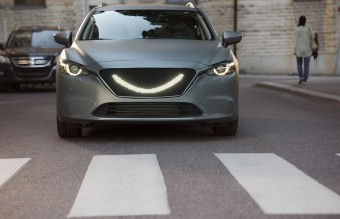 07-When-the-self-driving-car's-sensors-detect-a-pedestrian-a-smile-lights-up-at-the-front-of-the-car-and-the-car-stops
