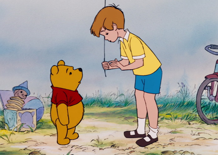 Winnie_the_Pooh_has_told_Christopher_Robin_he_wants_to_use_the_blue_balloon_to_get_honey