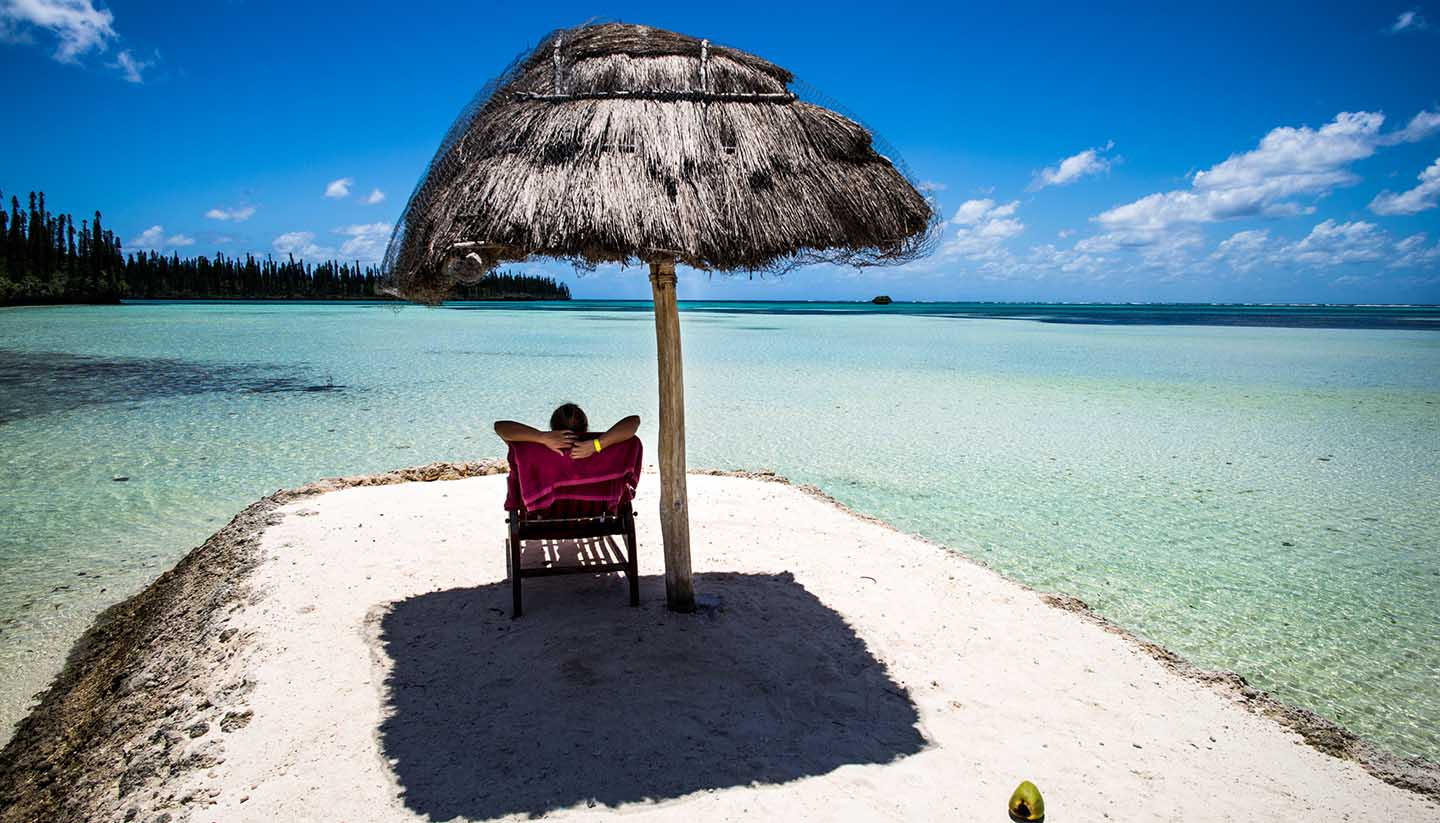 Person relaxing on a tropical beach