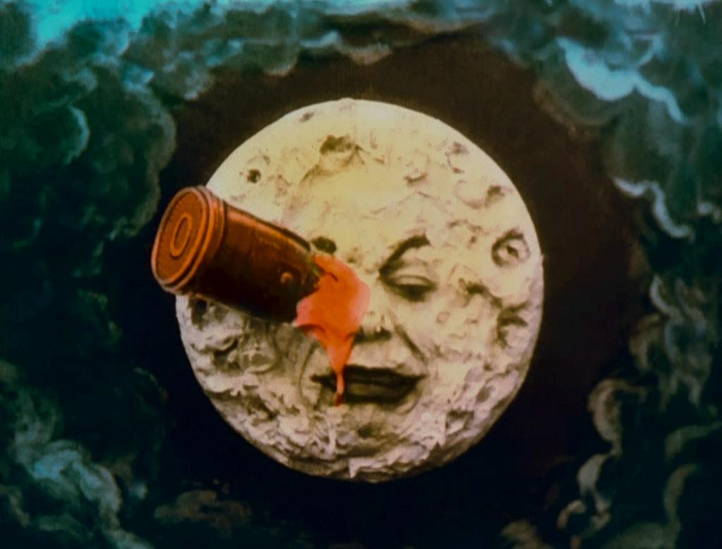le-voyage-moon-face-rocket-in-eye