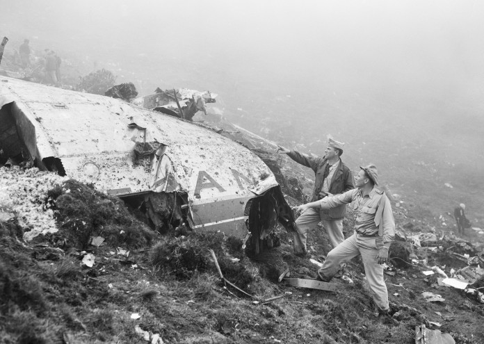 Officers Examine Aircraft Wreckage
