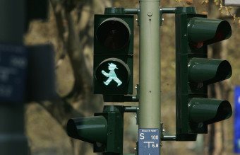 Legal Battle Emerges Over Stoplight Pedestrian Figure