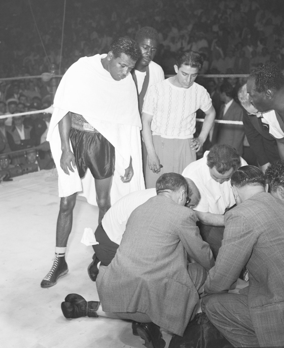 Sugar Ray Robinson Looking Over Doctors