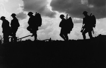 NLS_Haig_-_Troops_moving_up_at_eventide_-_men_of_a_Yorkshire_regiment_on_the_march_(cropped)