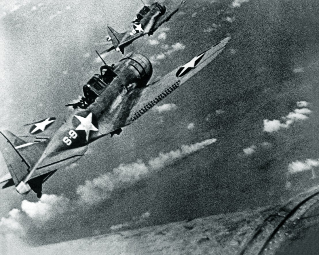 SBD-3_Dauntless_bombers_of_VS-8_over_the_burning_Japanese_cruiser_Mikuma_on_6_June_1942