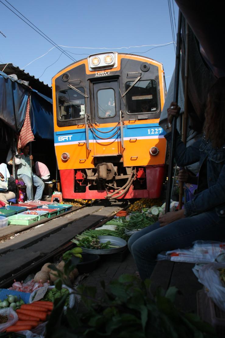 Train_at_Samut_Songkhram_market_on_the_rails