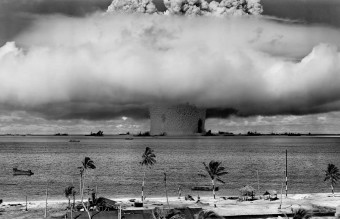 grayscale-photo-of-explosion-on-the-beach-73909