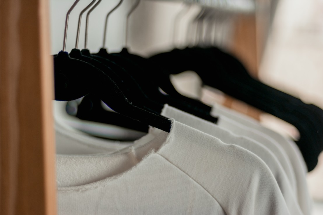 hanged-white-shirts-on-black-clothes-hangers-2112648