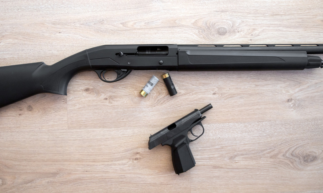 semi-automatic black hunting shotgun, cartridges 12 gauge, and makarov pistol