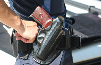 A woman with a Macarov gun in a black holster.