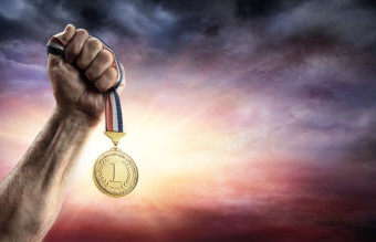 Medal Of First Place In Hand - Victory Concept - Medal 3d Rendering