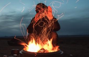 man-sitting-facing-fire-in-pot-during-night-2422968