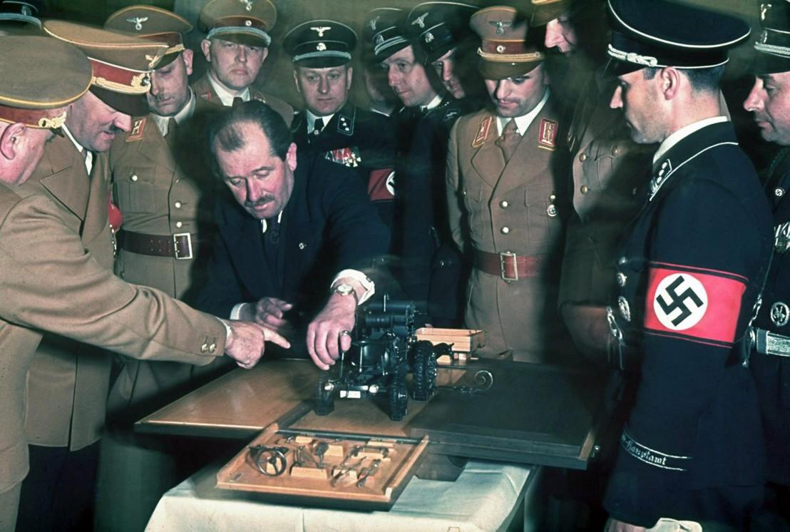 Ferdinand Porsche and Adolf Hitler.