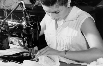 Woman_sewing_in_a_Puerto_Rico_garment_shop