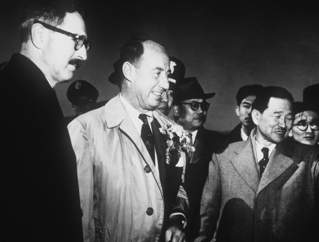 Stevenson_and_Korean_officials_at_USAF_base_in_Korea,_March_1953
