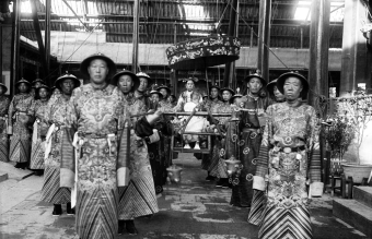 The_Qing_Dynasty_Cixi_Imperial_Dowager_Empress_of_China_On_Throne_Sedan_With_Palace_Enuches