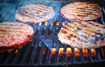 shallow-focus-photo-of-patties-on-grill-776314