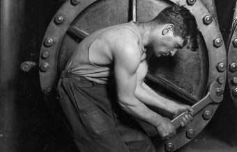 735px-Lewis_Hine_Power_house_mechanic_working_on_steam_pump