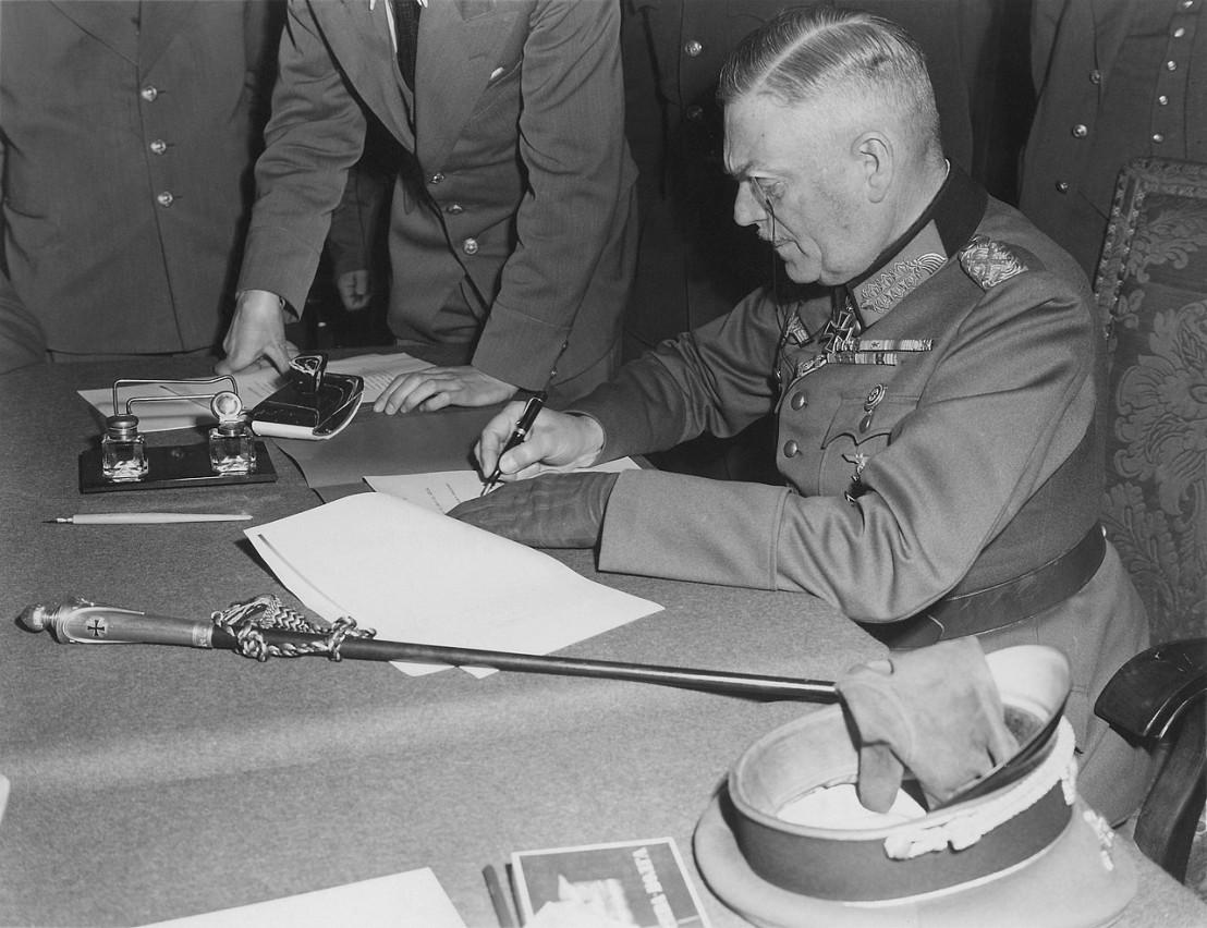 1280px-Field_Marshall_Keitel_signs_German_surrender_terms_in_Berlin_8_May_1945_-_Restoration