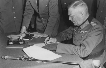 1280px-Field_Marshall_Keitel_signs_German_surrender_terms_in_Berlin_8_May_1945_-_Restoration