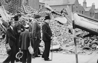 1280px-Winston_Churchill_visiting_bomb-damaged_areas_of_the_East_End_of_London,_8_September_1940._H3978
