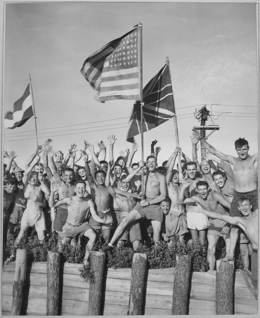 lossy-page1-837px-Gaunt_allied_prisoners_of_war_at_Aomori_camp_near_Yokohama_cheer_rescuers_from_U.S._Navy._Waving_flags_of_the_United..._-_NARA_-_520992.tif