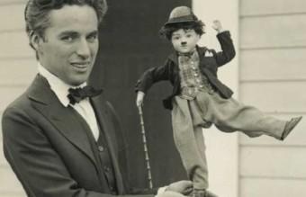 Charlie_Chaplin_with_doll