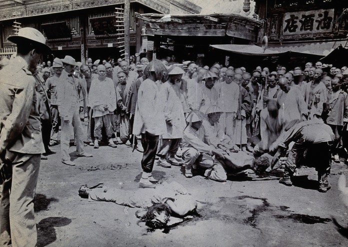V0031250 China: a man being beheaded, while the body of a man
